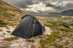 Wild camping Norway. This is a photo of two tents in Dovrefjell National park in Norway royalty free stock photography
