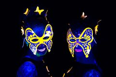 Photo of two women in luminous masks Royalty Free Stock Images