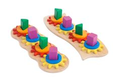 Photo of a wooden toy. Photo of a two wooden toys  children`s sorter with small wooden details in the form of gears, in different colors for the development of Royalty Free Stock Image