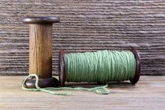 Wooden Bobbins with yarn Royalty Free Stock Images