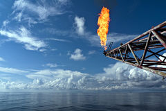 Flare Boom. Photo of typical oil rig flare boom at the off coast (seashore) basically to dissipate excess of gas or liquid hydrocarbon. This photo can be used to Royalty Free Stock Photography