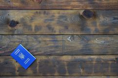 Photo of the Ukrainian foreign passport, lying on a dark wooden surface. The concept of introducing visa-free travel for Ukrainia. N citizens stock photos