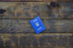 Photo of the Ukrainian foreign passport, lying on a dark wooden surface. The concept of introducing visa-free travel for Ukrainia. N citizens royalty free stock images
