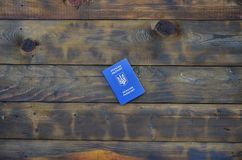 Photo of the Ukrainian foreign passport, lying on a dark wooden surface. The concept of introducing visa-free travel for Ukrainia. N citizens stock images