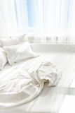 Photo of unmade bed against window royalty free stock photos