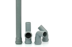 Photo of various PVC fittings for drainage. Used in water distribution systems, bathroom renovation concept Stock Image