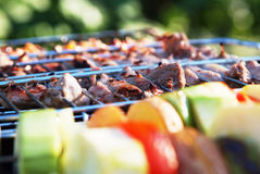 Photo of vegetables and barbecue.  Stock Photos