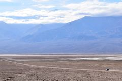 Vehicle driving alone in the Death Valley royalty free stock images