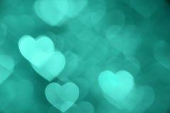 Photo verte de fond de bokeh de coeur, contexte abstrait de vacances Image libre de droits