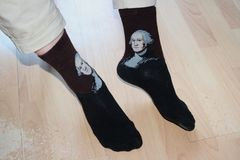 Socks with Mozart on the soft feet royalty free stock images