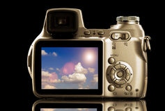 Photo Video Camera With Cloudscape On Display Stock Image