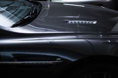 Back view of a modern luxury gray  metallic car, auto detail, car care concept in the garage stock photo