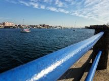 View over the Sheepshead Bay captured on a sunny day. Photo of a view over the Sheepshead Bay captured on a sunny day with the rail in the image royalty free stock image