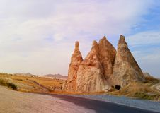 Photo views of the Cappadocia fortress Uchisar. Sunny afternoon Royalty Free Stock Images