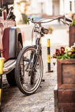 Photo of vintage bike parked on old street Stock Image