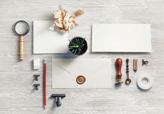 Photo of vintage stationery. Photo of blank vintage stationery set on light wooden background. Top view. Flat lay royalty free stock photos