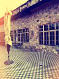 Sunny vintage street with coffee shop royalty free stock images
