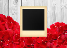 Photo in a vintage style beautiful red rose petals on white wood Royalty Free Stock Images