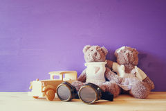Photo of vintage toy car and couple of cute teddy bears Royalty Free Stock Image