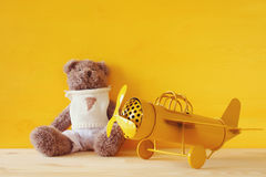 Photo of vintage toy plane and cute teddy bear Stock Photo