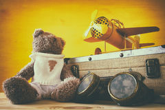 Photo of vintage toy plane and cute teddy bear Royalty Free Stock Images