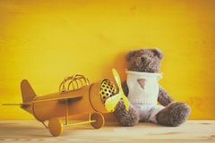 Photo of vintage toy plane and cute teddy bear Stock Image