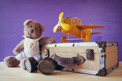 Photo of vintage toy plane and cute teddy bear Royalty Free Stock Photos