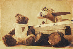 Photo of vintage toy plane and cute teddy bear Stock Images