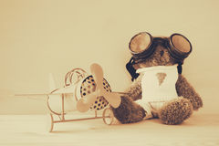 Photo of vintage toy plane and cute teddy bear Stock Photos