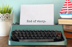 Photo of vintage typewriter with phrase: END OF STORY Royalty Free Stock Images