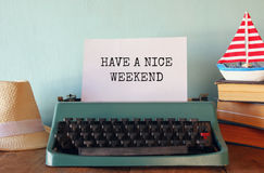 Photo of vintage typewriter with phrase, on wooden table Stock Images