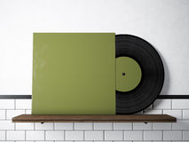 Photo vinyl music album template on natural wood bookshelf.White painted bricks wall background.Vintage style,high. Textured row materials.Green blank disk stock illustration