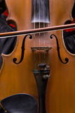 Photo of violin and fiddlestick, closeup. On black background Royalty Free Stock Photography