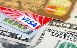 Photo of VISA and Mastercard credit card with american dollars. SAMARA, RUSSIA - FEBRUARY 4, 2015: Photo of VISA and Mastercard credit card with american dollars stock photography