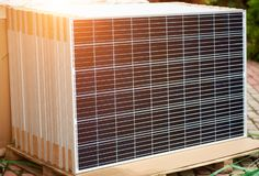 Photo voltaic panels set ready for transportation and installation. Renewable energy production. Close-up of new solar photo voltaic modules set outdoors ready stock photos