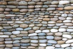 Photo of the wall exactly paved with stones Stock Photography