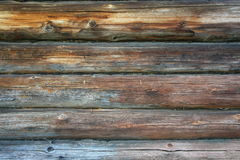 Photo wall of the old log houses. Photo old log walls of the hut with fragments of the remnants of blue paint Royalty Free Stock Photography