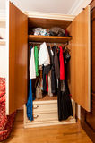 Photo of wardrobe with clothes on hangers in it Stock Photo