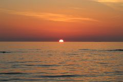 The nice sunset at the beach in Italy. This photo was Made on a afternoon in a place that called Marina di Massa in Italy with a view to the ocean. There was a royalty free stock photography