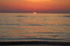 The nice sunset at the beach in Italy. This photo was Made on a afternoon in a place that called Marina di Massa in Italy with a view to the ocean. There was a royalty free stock image