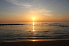 The nice sunset at the beach in Italy. This photo was Made on a afternoon in a place that called Marina di Massa in Italy with a view to the ocean. There was a stock image