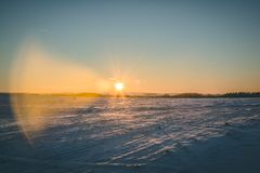 Winter sunset with beautiful sun light. royalty free stock image