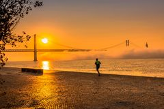 A Man Running at Gorgeous Orange Sunrise royalty free stock photography