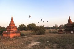 Balloons over Bagan at sunrise. This photo was taken Bagan, Myanmar. Bagan sunrises are truly iconic. Temples as far as the eye can see, a morning mist rising Royalty Free Stock Photography