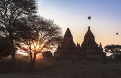 Balloons over Bagan at sunrise. This photo was taken Bagan, Myanmar. Bagan sunrises are truly iconic. Temples as far as the eye can see, a morning mist rising Royalty Free Stock Photos