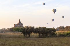 Balloons over Bagan at sunrise with horses. This photo was taken Bagan, Myanmar. Bagan sunrises are truly iconic. Temples as far as the eye can see, a morning Stock Image