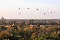 Balloons over Bagan at sunrise royalty free stock photography
