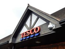 Tesco supermarket sign atop a store exterior royalty free stock image