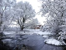 Darvells Pond, Chorleywood, Hertfordshire in winter snow and ice royalty free stock photography