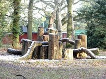 Wooden play area den in winter snow, Chorleywood Common stock photography
